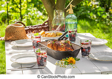 Healthy dinner with chicken and potatoes served in summer
