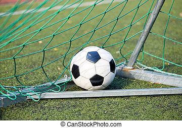 soccer ball at goal net on football field - sport, soccer...
