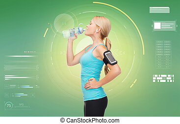 woman training drinking water from bottle - fitness, sport,...