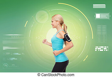 woman with earphones and smartphone doing sports - fitness,...
