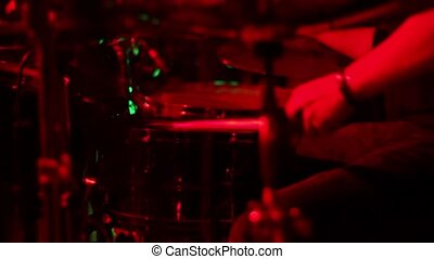 drumming in colored lights. metal concert. colorfull -...