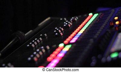 sound mixer control panel. focus transference. close-up -...