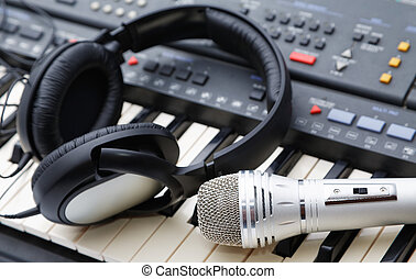 microphone and ear-phones lie on the keyboard