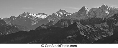 Eiger and other high mountains in the Bernese Oberland -...