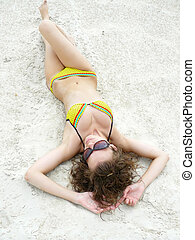 girl lies on sand - The sexual and young girl lies on sand