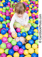 Children play in colorful balls