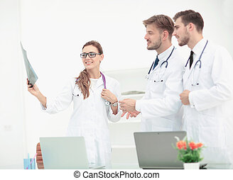 Portrait of group of smiling doctors working together and...