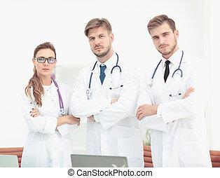 Portrait of a group of friendly doctors smiling. - Portrait...