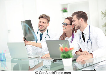 Portrait of group of smiling hospital colleagues working...