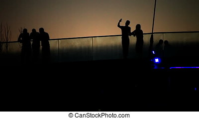 Group of People on Bridge Sunset Silhouette - Group of...