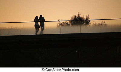 Lovers Couple at Dusk on Bridge