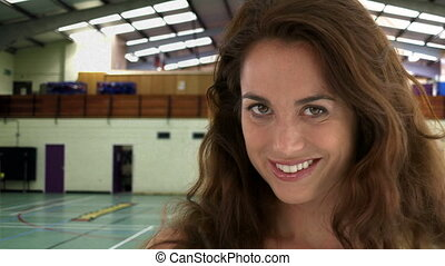 Beautiful woman looking at the camera in a gymnasium