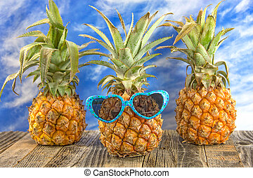 heart sunglasses on pineapple - pineapple on rustic wood...