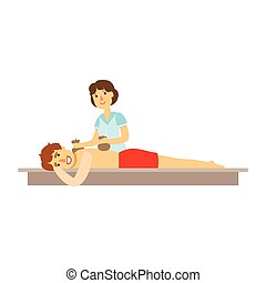 Young man receiving massage with two bags for a massage....