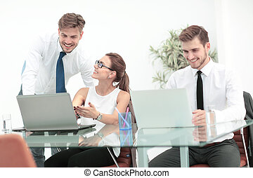 Photo of a young business team working in a modern office -...