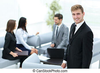 Business people working around table in modern office