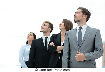 Group of happy and successful business people looking up -...