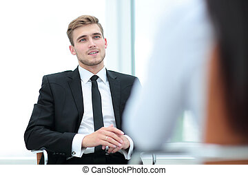 Portrait of confident business man talking with his collegue
