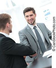 Two successful business men discussing documents in a modern...