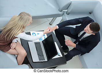 Confident business partners working in office and talking -...