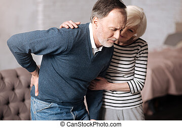 Senior man with terrible backache near wife - Too strong....