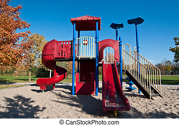 Park with Playground Equipment in Autumn