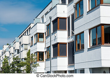 White serial houses in Berlin - White serial houses seen in...