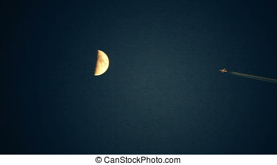 Jet Flying Above Moon - Jet flying above moon at sunset...