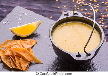 Lentil cream soup with toasts and a lemon