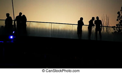 People Taking Selfie and Walking Bridge Sunset Back Lit...