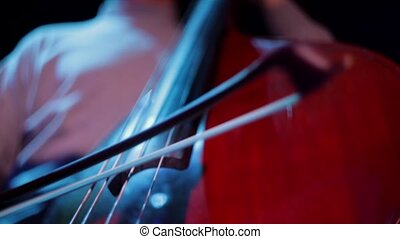 Man plays cello view from below. - Man plays cello view from...