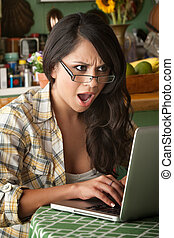 Shocked Beautiful Latina Woman with Computer - Shocked...