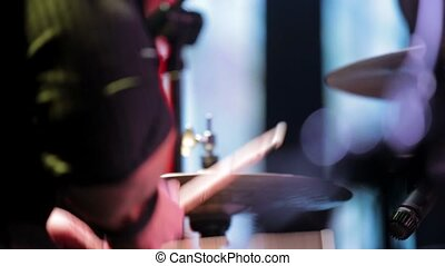 A person's hands are beating on the drum plates.