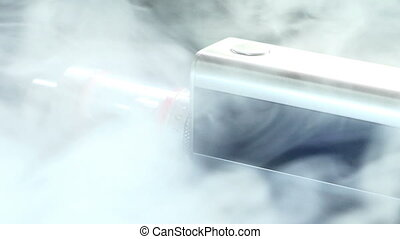 Electronic cigarette close-up on a black background in smoke