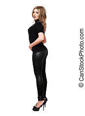 Attractive young woman in leggings. Isolated
