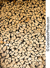 wall firewood , Background of dry chopped firewood logs in a...
