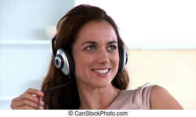 Pretty woman  communicating by means of  headset