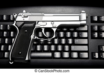 Internet crime - Handgun and computer keyboard