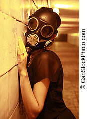 Gas mask - Woman in a gas mask in the night tunnel
