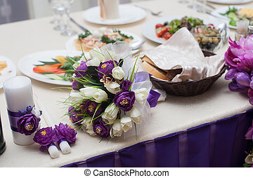 Beautiful decor of flowers at the wedding table.
