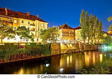 Ljubljanica river waterfront in Ljubljana evening view,...