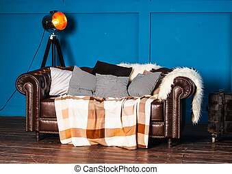 Leather sofa with light cushions