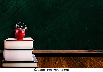 Apple Alarm Clock on Stack of Books and Chalkboard...