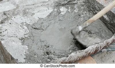 Industry, hand making mortar - Worker mixing mortar using...