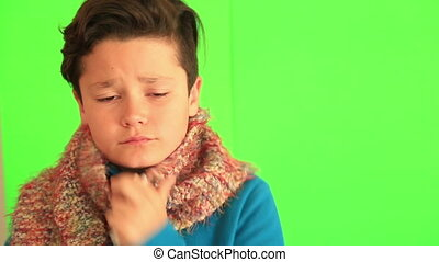 Sick child with chroma green screen - Winter portrait of...