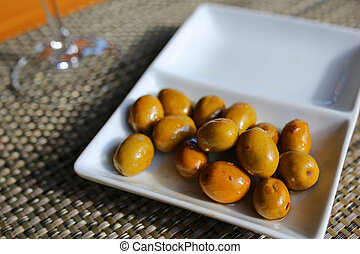 bowl with green olives- traditional spanish tapa