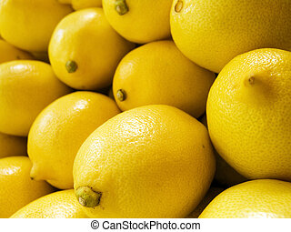 lemon macro - The beautiful yellow lemons on a counter
