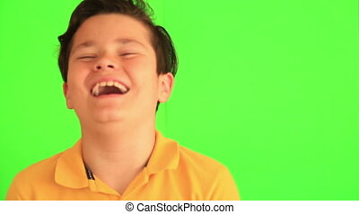 Handsome young boy laughing - Close up portrait of a happy...