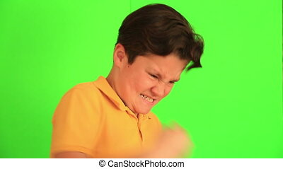 Angry child with choma green screen - Portrait of an angry...