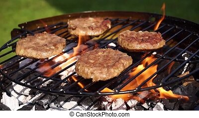Barbecue - Beef burgers cooking on a barbecue